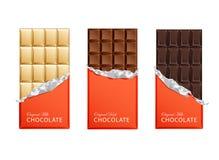 Шоколадные батончики конфеты темноты и молока в винтажных оболочках бара Стоковое фото RF