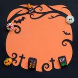 Шоколады призрака причудливые на предпосылке хеллоуина Стоковая Фотография