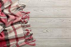Шотландка на светлой деревянной предпосылке Стоковые Фото