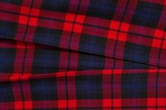 Шотландская картина тартана Красная печать шотландки как предпосылка Стоковые Фото