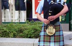 Шотландский волынщик на волынках Стоковые Фото