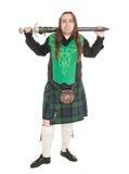 Шотландский человек в традиционном национальном костюме с шпагой Стоковая Фотография