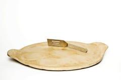 Шпатель на камне выпечки Стоковая Фотография