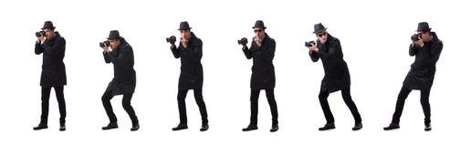 Шпионка при камера фотографируя изолированные на белизне стоковые фото