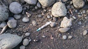Шприц на пляже Стоковая Фотография RF