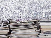 Штабелированные кассеты и Shredded бумага Стоковые Изображения