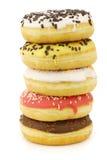 Штабелированные сортированные цветастые застекленные donuts Стоковое фото RF