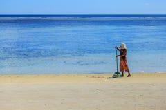 Штат в твердых частицах чистки принесенных пляжем моря Стоковая Фотография RF