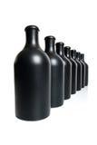 7 штейновых черных бутылок на белой предпосылке Стоковые Фото