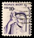 Штемпель напечатанный в США показывает созерцание правосудия стоковое фото