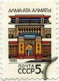 Штемпель напечатанный в СССР показывая город Алма-Ату, около 1990 стоковое изображение rf