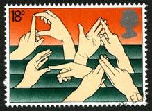 Штемпель почтового сбора Великобритании языка жестов стоковое фото rf
