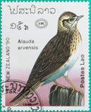 Штемпеля почтового сбора были напечатаны в Лаосе Стоковое Изображение RF