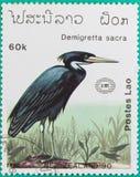 Штемпеля почтового сбора были напечатаны в Лаосе Стоковая Фотография