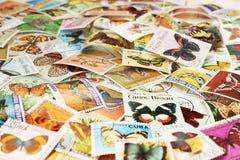 Штемпеля почтового сбора с бабочками Стоковые Изображения