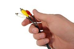 штепсельная вилка удерживания руки шнура Стоковые Изображения RF