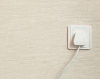 Штепсельная вилка AC в стенной розетке Стоковые Фото