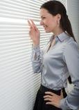 шторки смотря женщину окна стоковые изображения rf