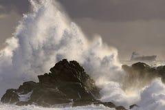 Шторм моря на заходе солнца Стоковые Фото