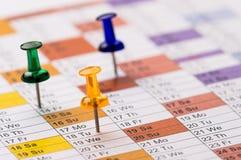Штыри на календаре стоковое фото rf