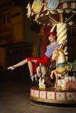 штырь девушки carousel вверх Стоковая Фотография