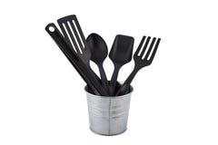 Шумовка черной пластичной кухни установленная, лопата сковороды в металле Стоковая Фотография RF