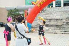 Шэньчжэнь, Китай: массы женских актеров Стоковые Изображения