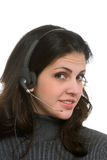 Женщина с шлемофоном стоковые изображения rf