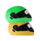 Шлемы велосипеда апельсина и зеленого цвета Стоковое Изображение RF