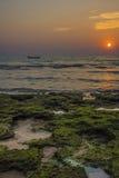Шлюпка в заходе солнца Стоковые Фотографии RF