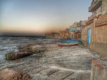 Шлюпка в линии пляжа Стоковое Фото