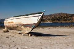 Шлюпка на береге Стоковые Изображения