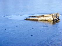 Шлюпка под льдом Стоковая Фотография RF