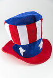 Шляпа патриотического стиля дядя Сэм красная, белая и голубая на белой предпосылке Стоковые Изображения RF