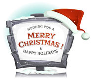 Шляпа Санта Клауса на смешном каменном знаке Стоковые Изображения