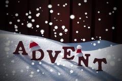 Шляпа Санты снега времени рождества пришествия средняя Стоковые Изображения RF