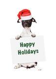 Щенок Санты с счастливым знаком праздников Стоковая Фотография