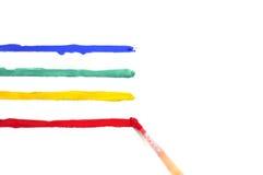 Щетка с краской и покрашенными нашивками Стоковая Фотография RF
