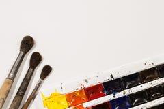 Щетки и краски акварели Стоковое Изображение