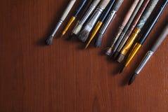 Щетки на деревянной поверхности Стоковые Фото