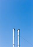 2 дымовой трубы на предпосылке голубого неба в Таиланде Стоковое Фото