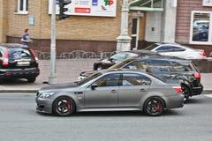 3-ье ноября 2013 Киев, Украина; BMW M5 в движении стоковые фотографии rf