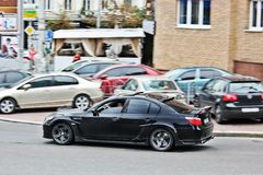 3-ье ноября 2013 Киев, Украина; BMW M5 HAMANN в движении на высокой скорости стоковое фото
