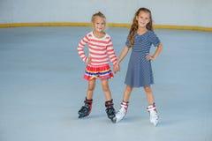 льдед девушки немногая катаясь на коньках Стоковое Изображение