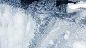 льдед предпосылки выравнивает картины Поверхность льда принятая полка изображения льда кристаллов Антарктики closeup Текущая вода сток-видео