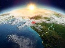 Экваториальная Гвинея от космоса в восходе солнца Стоковое фото RF