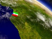 Экваториальная Гвинея с врезанным флагом на земле Стоковое Изображение RF