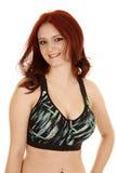 Экземпляр улыбки конца фитнеса бюстгальтера спорт волос женщины красный стоковое изображение rf