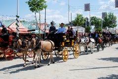Экипажи нарисованные лошадью на ярмарке Севильи Стоковые Изображения RF