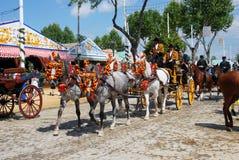 Экипажи нарисованные лошадью на ярмарке Севильи Стоковая Фотография